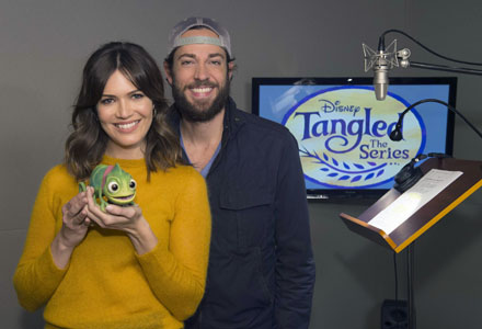 """Mandy Moore and Zachary Levi were greeted by a special visitor, Pascal (Rapunzel's pet chameleon) in the form of an Audio-Animatronics character created by Walt Disney Imagineering, at a voice recording session for Disney's upcoming """"Tangled: The Series"""" in Burbank, California on October 4, 2016.  (Disney Channel/Matt Petit)"""